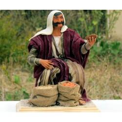 Homme aux graines assis